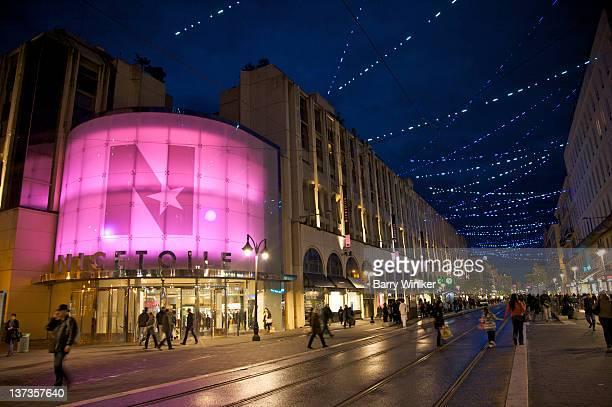 Large lit shopping centre at dusk.