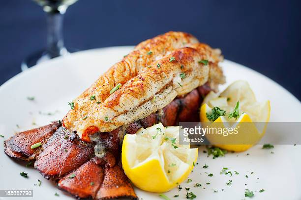 Large lobster tail served with white wine