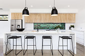 Large white luxury Australian kitchen with marble island bench
