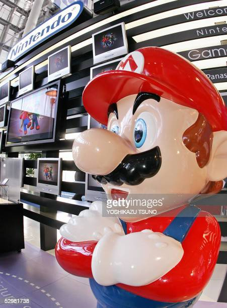 A large mascot of Nintendo's popular game character SuperMario stands at a showroom in Tokyo 26 May 2005 Japan's video game giant Nintendo said its...