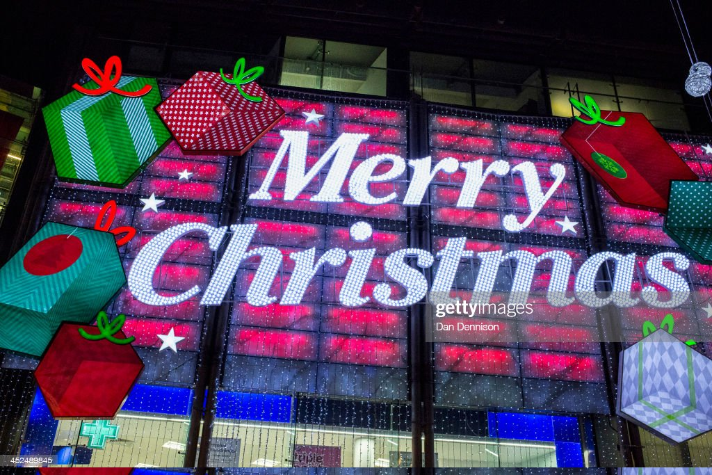 A large 'Merry Christmas' sign entices shoppers into a high street pharmacy chain on November 29, 2013 in London, United Kingdom. Though traditionally a US phenomenon, 'Black friday' sales appear to have taken hold in the UK with many retailers offering large discounts for one day only, mimicking the behaviour of their American counterparts.