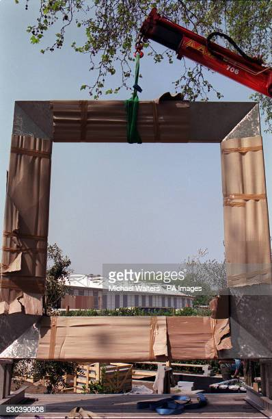 A large metal frame is positioned into place in the Evening Standard show garden during the build up to the Chelsea Flower Show 2000 The garden has...