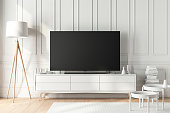 Large modern Smart Tv Mockup on white consоle in beautiful living room. 3d rendering