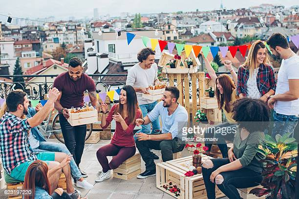 Large multi-ethnic group on a rooftop party