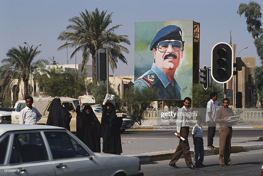 A large mural depicting President <a gi-track='captionPersonalityLinkClicked' href=/galleries/search?phrase=Saddam+Hussein&family=editorial&specificpeople=121553 ng-click='$event.stopPropagation()'>Saddam Hussein</a> in a Baghdad street, 1989.