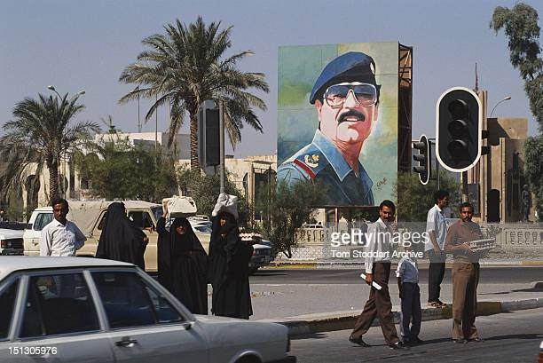 A large mural depicting President Saddam Hussein in a Baghdad street 1989