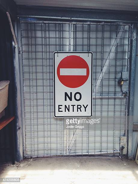 Large 'No Entry' sign on inside door of warehouse