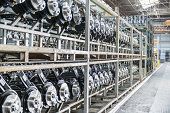Large number of axles on shelving unit in car plant