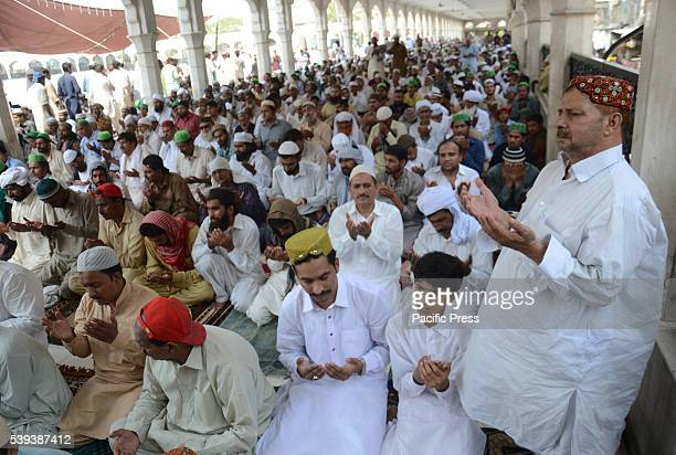 A large number of Muslims offering first NamazeJuma of Holy Fasting Month of RamzanulMubarak at Data Darbar Mosque Islam's holy month of Ramadan is...