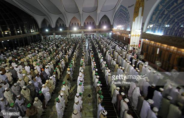 A large number of Pakistani faithful Muslims offering NamazeTaraweeh after sighting the moon of Holy Fasting Month of RamadanulMubarak in Lahore...