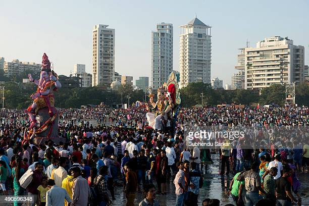 A large number of people crowd at Girgaum CHowpatty beach in Mumbai on the occasion of the immersion of lord Ganesha Ganesha Chaturthi or Ganapati...