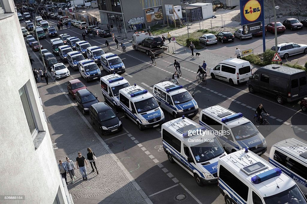 A large number of police vans drive through the streets on May Day on May, 2016 in Berlin, Germany. Tens of thousands of people across Germany participated in marches and gatherings by labor unions and in some cities left-wing and anarchist activists took to the streets under heavy oversight by police. In Berlin far-right protesters also attempted to hold rallies during the day.