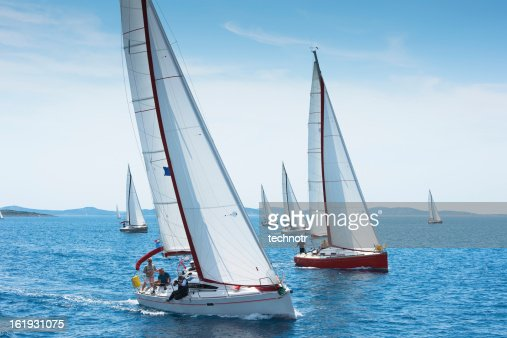 Large number of sailboats racing at regatta