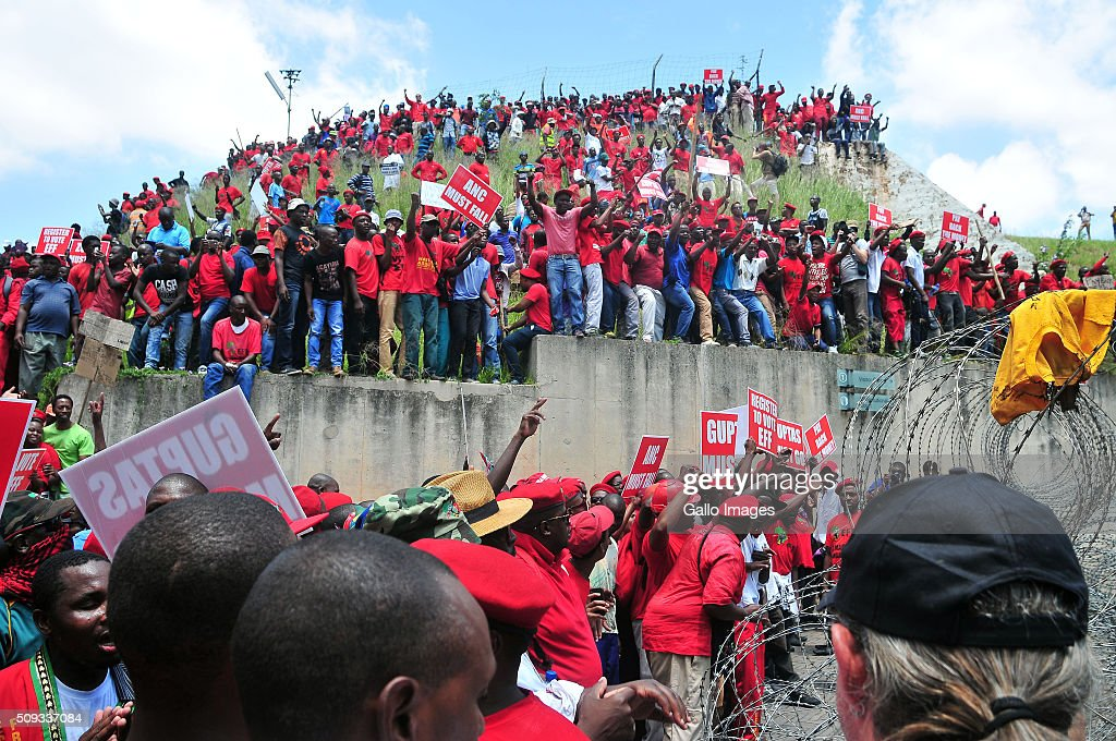 Large numbers of EFF marchers displaying various placards gather outside the Constitutional Court on February 9 2016 in Johannesburg South Africa...