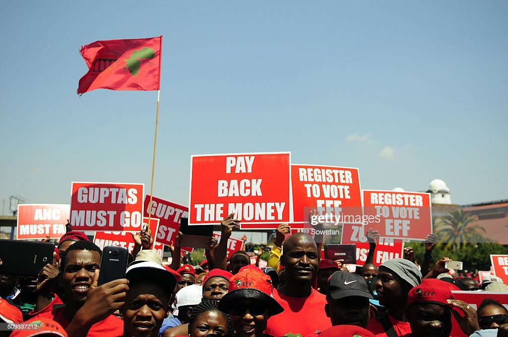 Large numbers of EFF marchers gather outside the Constitutional Court on February 9 2016 in Johannesburg South Africa Large numbers of EFF supporters...