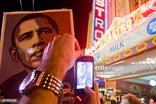 CONTENT] Large Obama poster on picket sign in street crowd celebrating Obama's election in front of the historical Castro theater in San Francisco's...