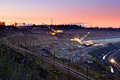 Large open pit at night