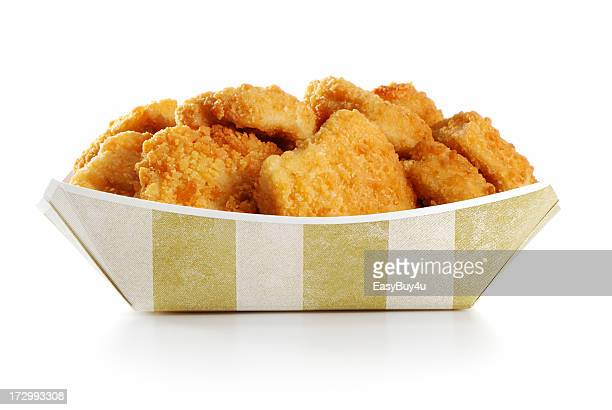 A large order of chicken nuggets in a paper tray