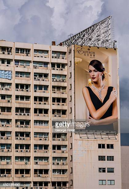 A large outdoor billboard promoting the Emperor Hotel hangs on the side of the hotel in Kowloon on May 24 in Hong Kong China Viewed as the world's...