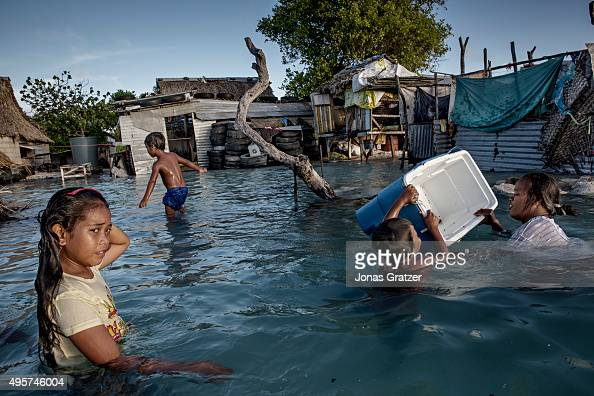 Large parts of the village Eita has drowned in flooding from the sea The people of Kiribati are under pressure to relocate due to sea level rise Each...