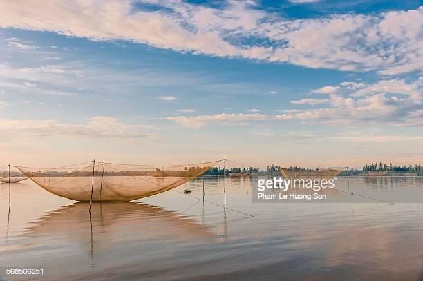 Large permanent fishing nets on tidal river