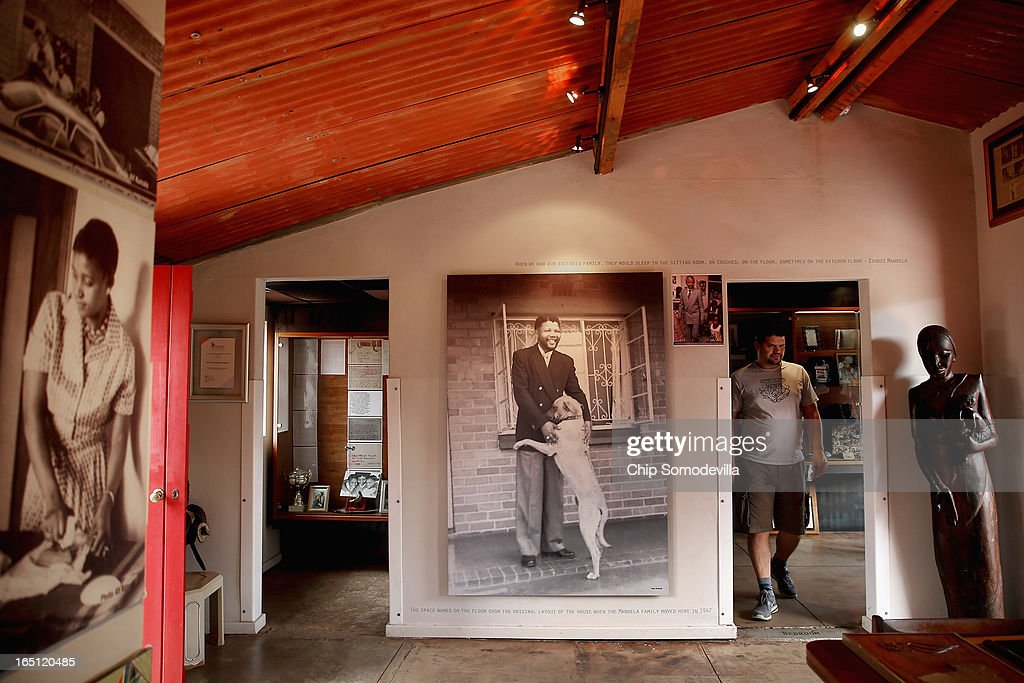 A large photograph of former South African President Nelson Mandela the day before he went to prison in 1962 hangs inside the Mandela House and Museum on historic Vilakazi Street in Soweto March 31, 2013 in Johannesburg, South Africa. From 1946 to 1990 this was the home of Mandela, 94, who is in the hospital for the third time since December with lung problems. Referring to Mandela by clan name, Madiba, President Jacob Zuma said, 'We appeal to the people of South Africa and the world to pray for our beloved Madiba and his family and to keep them in their thoughts.' Mandela's lungs were damaged when he contracted tuberculosis during his 27 years in the infamous Robben Island prison. Mandela became the nation's first democratically elected president in 1994 following the end of apartheid.
