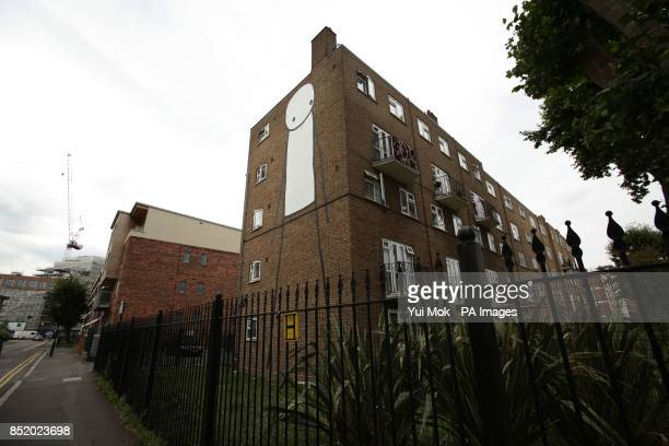 A large piece of graffiti on the side of a block of flats on Scriven Street in Dalston east London by street artist Stik