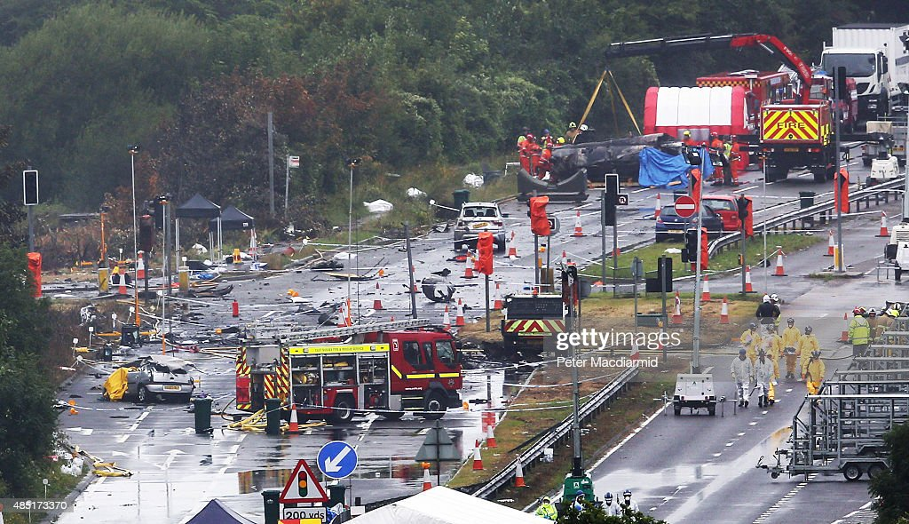 A large piece on the crashed Hawker Hunter fighter jet is lifted by crane on August 25 2015 in Shoreham England The aircraft came down while...