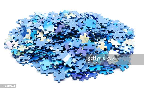 Large pile of blue hued jigsaw pieces