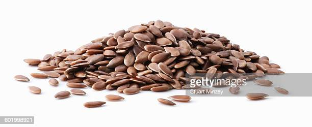 Large pile of linseed on white background
