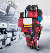 Huge stack of suitcases on a cart in the airport terminal