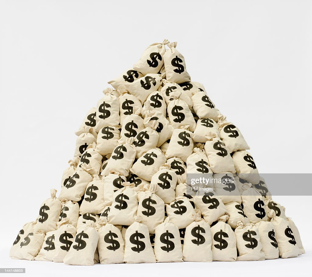 Large pile of money bags in a pyramid shape. : Foto de stock