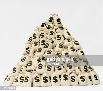 Large pile of money bags in a pyramid shape. : Stock-Foto