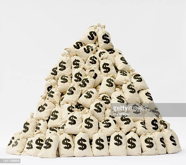 Large pile of money bags in a pyramid shape.