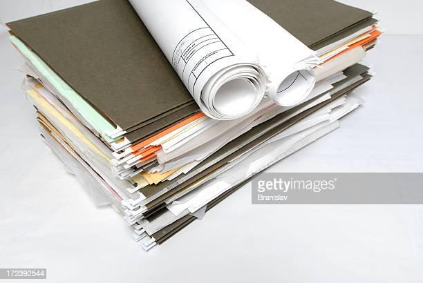 Large pile of ufinished paperwork