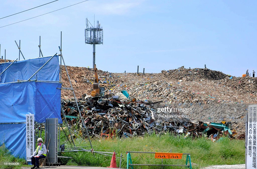 Large piles of debris washed away during last year's tsunami is piled high at a temporary dump site on September 10, 2012 in Ishinomaki, Miyagi, Japan. The debris will be shipped to Kitakyushu to dispose. 18 months on, still 2,814 people are missing and 340,000 people are forced to live at temporary housing.