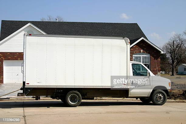 Large plain white removal van parked outside of a house