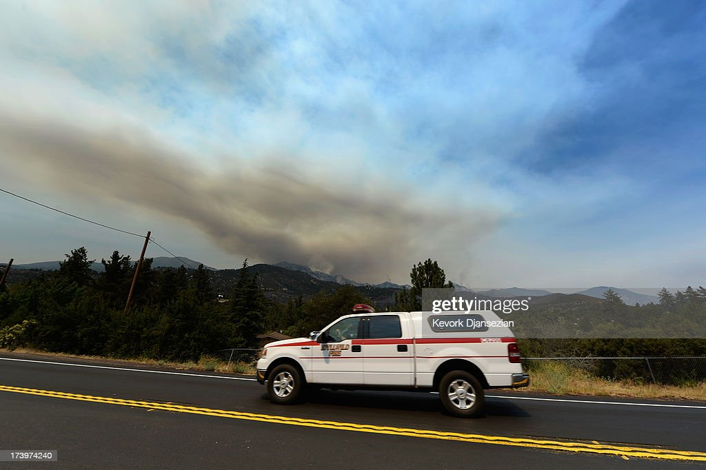 A large plum of smoke is seen from the Mountian Fire on July 18, 2013 in Idyllwild, California. The massive wildfire in Riverside county has grown to 23,000 acres and is advancing towards the mountain town of Idyllwild on one front and city of Palm Springs on the other front destroying several homs and forcing the evacuation of 6,000 people.