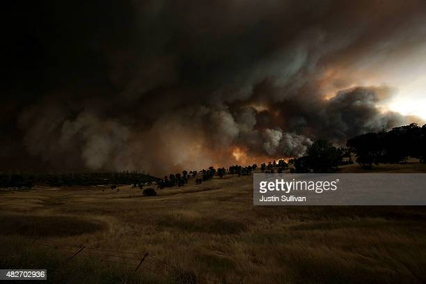A large plume of smoke rises from the Rocky Fire on August 1 2015 near Clearlake California Over 1900 firefighters are battling the Rocky Fire that...