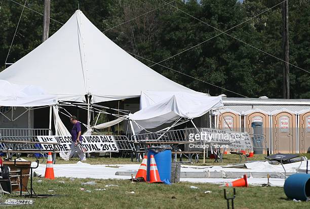 Large poles and a tent lie on the ground after severe weather caused a tent to collapse at the Prairie Fest on Aug 2 2015 in Wood Dale Ill According...