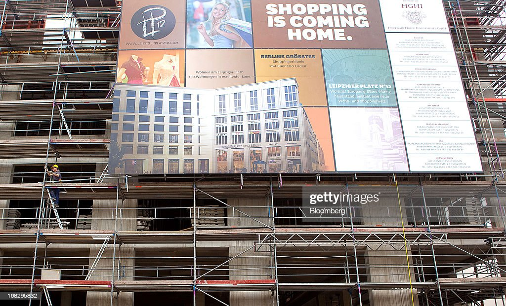 A large poster advertises the building development for the Leipziger Platz shopping mall, Berlin's largest commercial project by developer High Gain House Investments GmbH (HGHI), in Berlin, Germany, on Wednesday, May 8, 2013. Germany, Europe's largest economy, reported growth in the construction industry during April, according to Markit Economics. Photographer: Krisztian Bocsi/Bloomberg via Getty Images