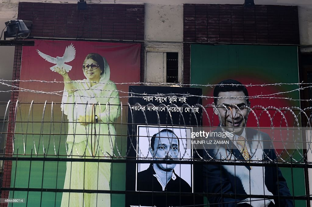 A large poster of opposition Bangladesh Nationalist Party (BNP) leader, <a gi-track='captionPersonalityLinkClicked' href=/galleries/search?phrase=Khaleda+Zia&family=editorial&specificpeople=647544 ng-click='$event.stopPropagation()'>Khaleda Zia</a> (L) is seen with her two sons late Arafat Rahman Koko (C) and <a gi-track='captionPersonalityLinkClicked' href=/galleries/search?phrase=Tarique+Rahman&family=editorial&specificpeople=4183399 ng-click='$event.stopPropagation()'>Tarique Rahman</a> (R) is seen in front of opposition Bangladesh Nationalist Party (BNP) office during an ongoing nationwide strike and blockade called by the Bangladesh Nationalist Party (BNP)-led alliance in Dhaka on February 26, 2015. A Bangladeshi court on February 25, issued an arrest warrant for opposition leader <a gi-track='captionPersonalityLinkClicked' href=/galleries/search?phrase=Khaleda+Zia&family=editorial&specificpeople=647544 ng-click='$event.stopPropagation()'>Khaleda Zia</a> for failing to attend hearings on graft charges, amid fears the move will worsen weeks-long deadly political turmoil. AFP PHOTO / Munir uz ZAMAN