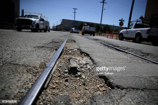 A large pothole is visible on 20th Street on July 12 2017 in Oakland California According to a report by WalletHub roads in San Francisco Oakland and...