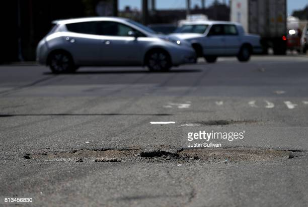 A large pothole is visible on Campbell Street on July 12 2017 in Oakland California According to a report by WalletHub roads in San Francisco Oakland...