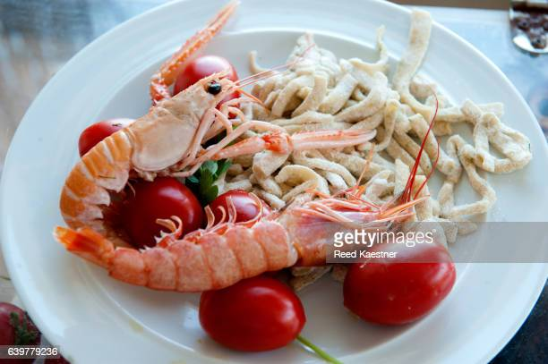 Large prawns and linguini served for lunch in Capri, Italy