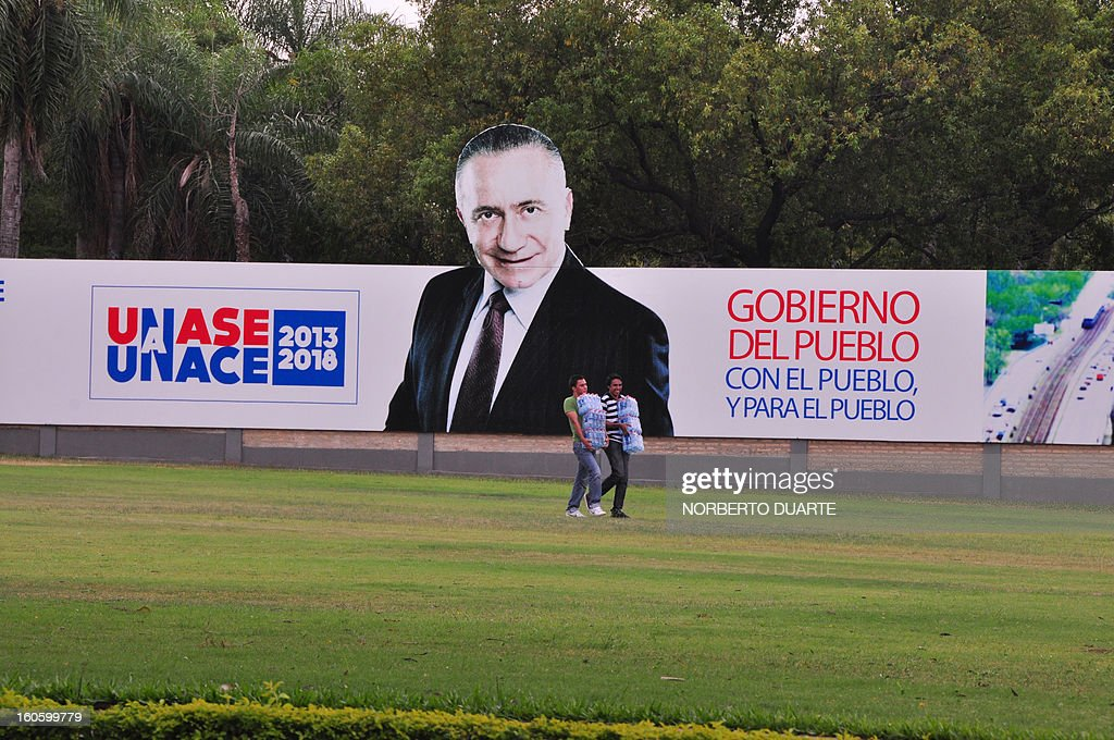 A large prpaganda billboard of former Paraguayan general and presidential candidate for the UNACE party, Lino Oviedo, at the party's headquarters in Asuncion on February 3, 2013. Oviedo died on the eve in a helicopter crash whilst returning from a campaign rally in Concepcion. All three passengers of the aircraft --Ovideo, his bodyguard and the pilot-- died in the accident. AFP PHOTO Norberto Duarte