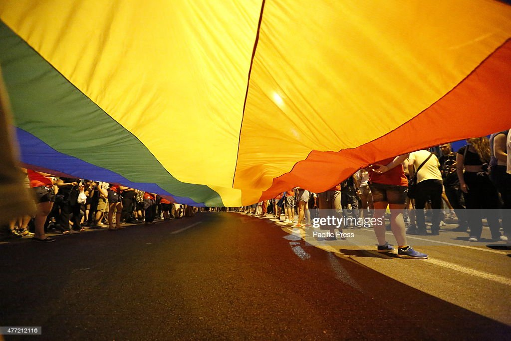 SQUARE ATHENS ATTICA GREECE A large rainbow flag is carried passed the Greek Parliament at the 10th Athens Gay Pride Parade 2015Several thousand...