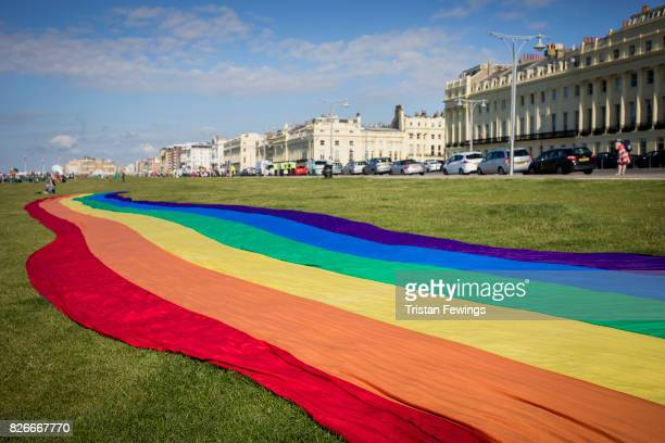 BRIGHTON ENGLAND AUGUST A large rainbow Pride banner is spread out ahead of the annual Brighton Pride Parade And Festival on August 5 2017 in...