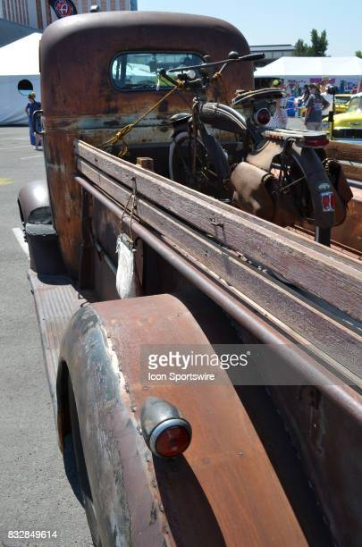 Large rear truck bed on this 1937 GMC COE has plenty of room to carry an original motorbike at the Hot August Nights Custom Car Show the largest...
