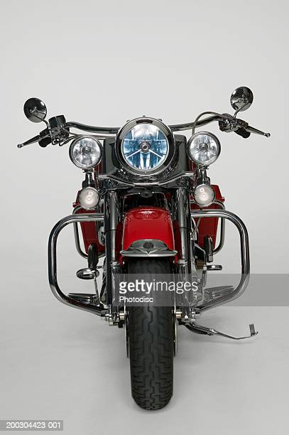 Large red motorbike in studio, front view